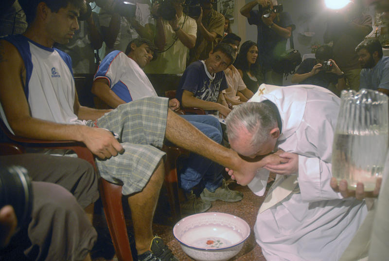 In this picture taken March 20, 2008 Argentina's cardinal Jorge Bergoglio, right, kisses the feet of a man during a mass with youth trying to overcome drug addictions in Buenos Aires, Argentina. Bergoglio, who chose the name of Pope Francis, is the 266th pontiff of the Roman Catholic Church. The famous words uttered to announce that a leader of the Catholic Church has been chosen now have special resonance for Latin America, which had felt neglected by the Vatican and has finally produced the New World's first pope.(AP Photo/Str )
