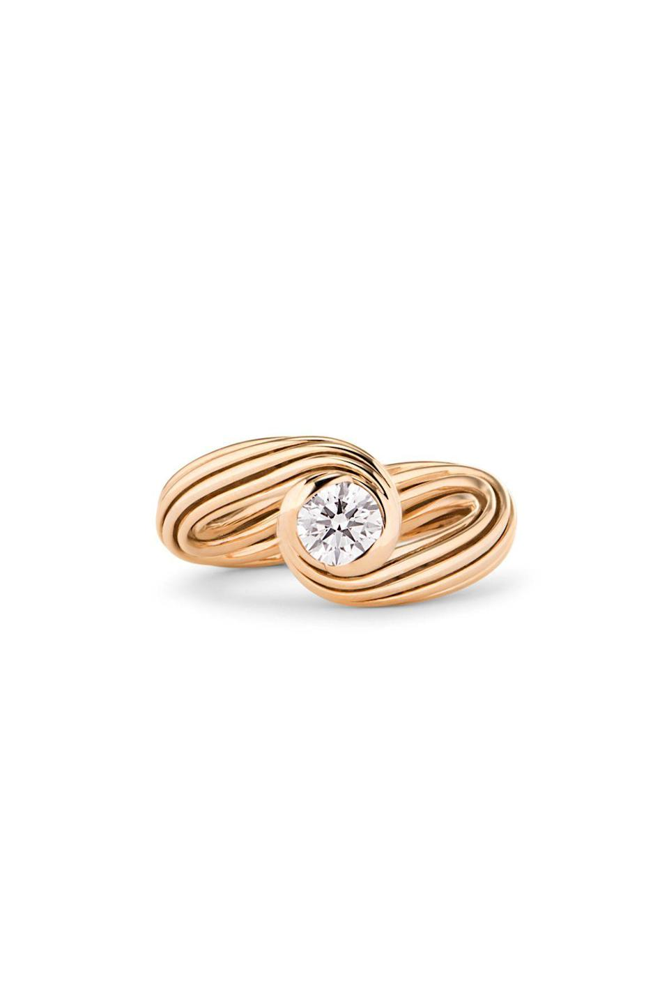 """<p><strong>By Kim</strong></p><p>wempe.com</p><p><strong>$8375.00</strong></p><p><a href=""""https://www.wempe.com/en-us/jewelry/by-kim/helioro-by-kim/helioro-solitaire-ring-10rg1867?c=6312"""" rel=""""nofollow noopener"""" target=""""_blank"""" data-ylk=""""slk:Shop Now"""" class=""""link rapid-noclick-resp"""">Shop Now</a></p><p>This is a solitaire with swagger: nine bands of rose gold are wrapped and twisted to sweep around a brilliant-cut diamond. </p>"""