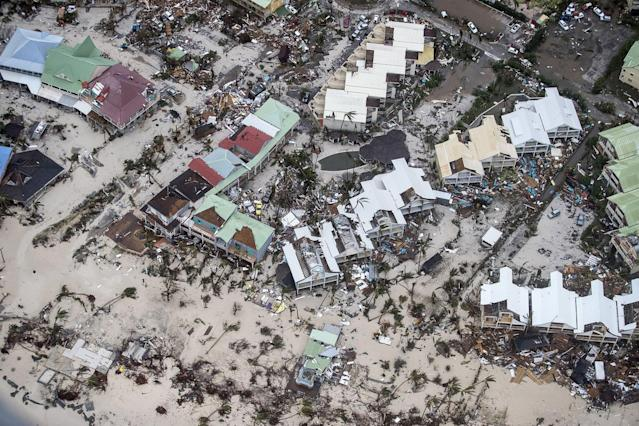 <p>SEPT. 6, 2017 – An aerial photo shows the damage of Hurricane Irma in Orient Bay, on the French side of the Caribbean island of Saint Martin.<br> Hurricane Irma sowed a trail of deadly devastation through the Caribbean reducing to rubble the tropical islands of Barbuda and St Martin. (Photo: Gerben Van Es /AFP/Getty Images) </p>