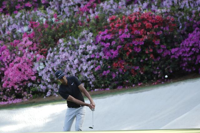 Tony Finau of the U.S. chips to the 13th green during first round play of the 2018 Masters golf tournament at the Augusta National Golf Club in Augusta, Georgia, U.S., April 5, 2018. REUTERS/Mike Segar