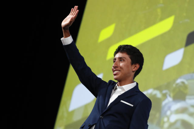 Colombia's Egan Bernal waves to the public during the presentation of the Tour de France 2020 cycling race, in Paris, Tuesday Oct. 15, 2019. The 107th edition of the race starts on June 27 2019 to end on the Champs-Elysees avenue on July 19. (AP Photo/Thibault Camus)