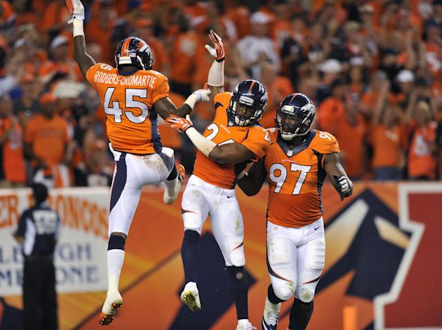 Denver Broncos' Dominique Rodgers-Cromartie (45), Rahim Moore (26) and Malik Jackson (97) celebrate a stop against the Baltimore Ravens during the second half of an NFL football game, Thursday, Sept. 5, 2013, in Denver. (AP Photo/Jack Dempsey)