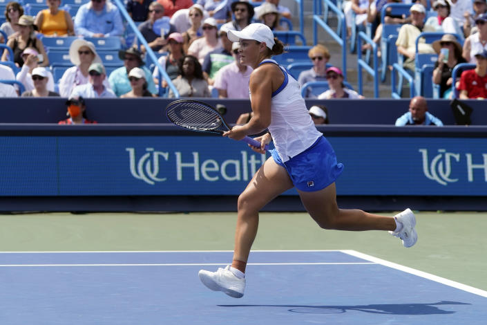 Ashleigh Barty, of Australia, runs after a shot by Jil Teichmann, of Switzerland, in the women's single final of the Western & Southern Open tennis tournament, Sunday, Aug. 22, 2021, in Mason, Ohio. (AP Photo/Darron Cummings)