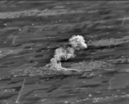 A frame grab taken from footage released by Russia's Defence Ministry October 10, 2015, shows what Russia says is smoke rising after airstrikes carried out by the Russian air force on an Islamic State command post in Raqqa province, Syria. REUTERS/Ministry of Defence of the Russian Federation/Handout via Reuters