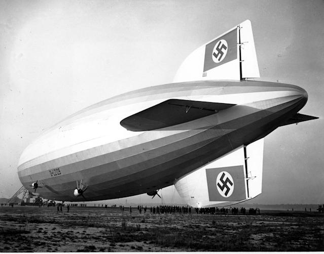 <p>The German zeppelin Hindenburg, displaying the German Nazi swastika symbol, is pulled to a nearby hangar in Lakehurst, N.J. on May 9, 1936. The Hindenburg landed at the U.S. Navy field after its record breaking flight for a lighter-than-air craft across the North Atlantic. (AP Photo) </p>