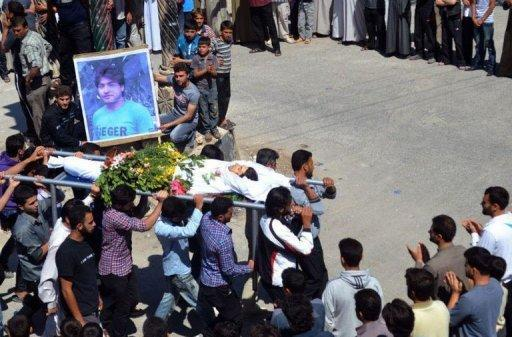 An image by the Shaam News Network shows mourners carrying the body of a youth allegedly killed by the government