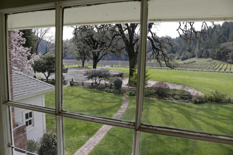 """In this photo taken March 15, 2013 a view of vineyards at the MacMurray Ranch is seen from an upstairs window in actor Fred MacMurray's home in Healdsburg, Calif. The former cattle ranch, which was purchased in 1941 by the actor in the popular TV series """"My Three Sons,"""" now produces wine and is owned by the Gallo wine family. (AP Photo/Eric Risberg)"""