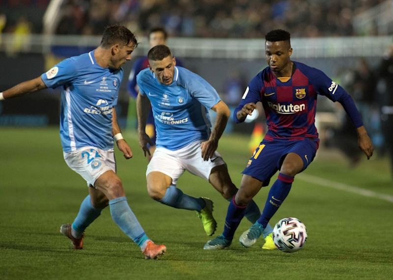 Barcelona's Guinea-Bissau forward Ansu Fati (R) vies with UD Ibiza's forward Josep Caballe (C) and UD Ibiza's defender Kike Lopez during the Copa del Rey (King's Cup) football match between UD Ibiza and FC Barcelona at the Can Misses municipal stadium in Ibiza, on January 22, 2020. (Photo by JAIME REINA / AFP) (Photo by JAIME REINA/AFP via Getty Images)