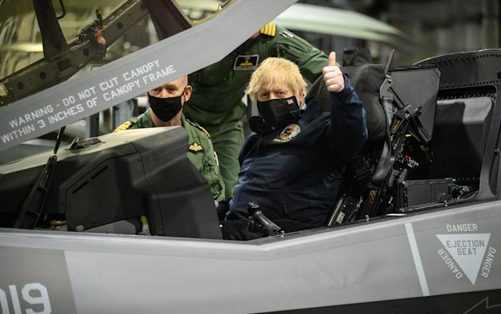 Boris Johnson sits in the cockpit of an Lockheed Martin F-35 Lightning II during a visit to HMS Queen Elizabeth aircraft carrier - Leon Neal/Getty Images