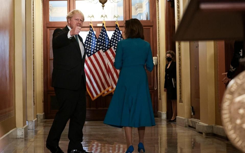 Boris Johnson gives a thumbs up to a reporter as he walks with House Speaker Nancy Pelosi - Getty