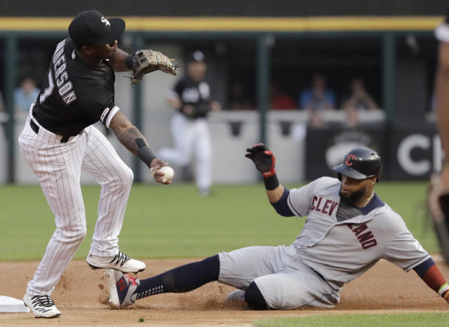 Chicago White Sox shortstop Tim Anderson, left, throws to first after forcing out Cleveland Indians' Carlos Santana, right,at second during the first inning of a baseball game in Chicago, Friday, May 31, 2019. Jason Kipnis was safe at first. (AP Photo/Nam Y. Huh)