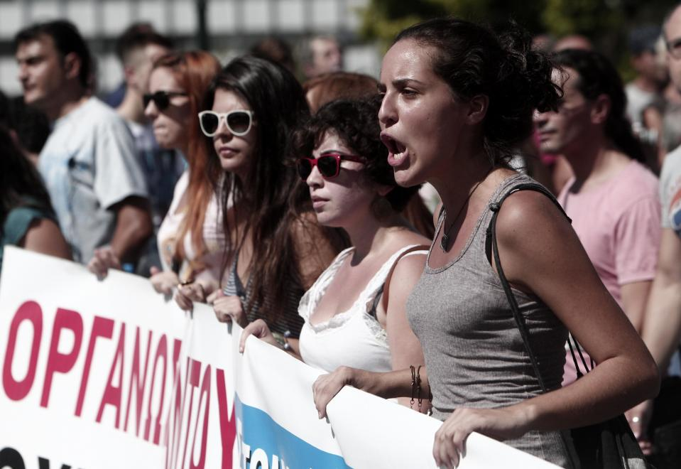 Protesters of the Greek Communist party affiliated unions march in front of the Greek Parliament in Athens Wednesday Sept. 26, 2012. Greek workers walked off the job Wednesday for the first general strike since the country's coalition government was formed in June, as the prime minister and finance minister hammered out a package of euros 11.5 billion ($14.87 billion) in spending cuts. Athens has struggled to come up with more punishing austerity measures that would be acceptable to its rescue creditors, with disagreements arising between the three parties that make up the coalition government. Greece's creditors have demanded more fiscal reforms if they are to continue handing out rescue loans preventing the country from a messy default that could roil the euro. (AP Photo/Nikolas Giakoumidis)