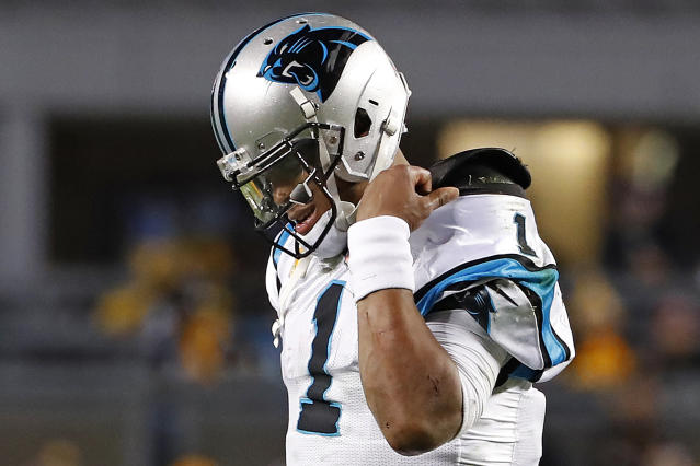 Carolina Panthers quarterback Cam Newton walks off the field after being sacked by the Pittsburgh Steelers during the second half of an NFL football game in Pittsburgh, Thursday, Nov. 8, 2018. The Steelers won 52-21. (AP Photo/Don Wright)