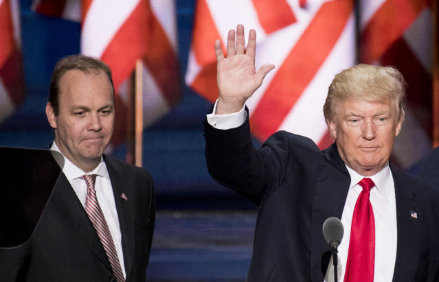 Rick Gates looks on as Donald Trump checks out the podium in preparation for accepting the GOP presidential nomination at the 2016 Republican National Convention in Cleveland on July 20, 2016. (Photo: Bill Clark/CQ Roll Call/Getty Images)