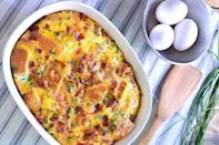 """<p>This strata is like a frittata and bread pudding in one. You whisk the eggs and milk with the cubed bacon, chives and cheese and then pour the whole thing over the cubed bread in the baking dish. To make this ahead, just cover the dish and pop in the fridge to bake later. </p> <p><a href=""""https://www.thedailymeal.com/best-recipes/bacon-cheddar-strive-strata?referrer=yahoo&category=beauty_food&include_utm=1&utm_medium=referral&utm_source=yahoo&utm_campaign=feed"""" rel=""""nofollow noopener"""" target=""""_blank"""" data-ylk=""""slk:For the Bacon, Cheddar and Chive Strata recipe, click here."""" class=""""link rapid-noclick-resp"""">For the Bacon, Cheddar and Chive Strata recipe, click here.</a></p>"""