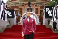 Daniel Craig poses for photographers upon arrival for the World premiere of the new film from the James Bond franchise 'No Time To Die', in London Tuesday, Sept. 28, 2021. (Photo by Joel C Ryan/Invision/AP)