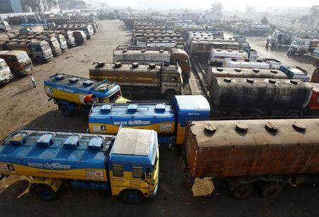 FILE PHOTO: Oil tankers are seen parked at a yard outside a fuel depot on the outskirts of Kolkata
