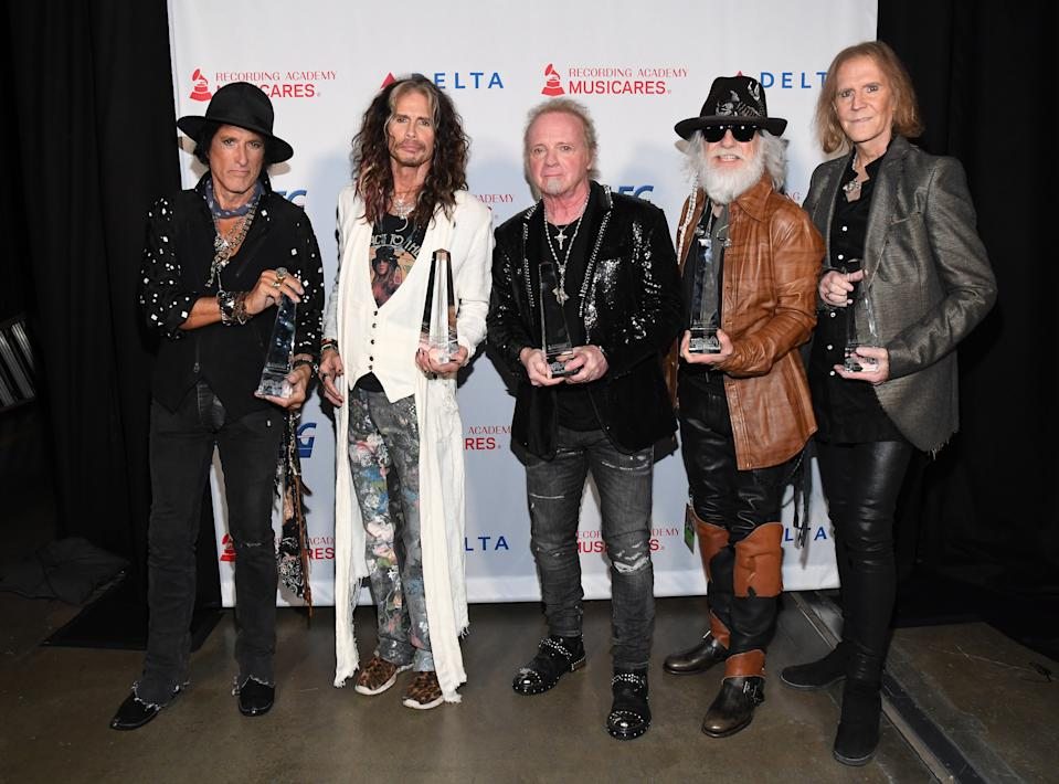 Honorees Joe Perry, Steven Tyler, Joey Kramer, Brad Whitford, and Tom Hamilton of music group Aerosmith, recipients of the Person of the Year award. (Photo: Kevin Mazur/Getty Images for The Recording Academy)