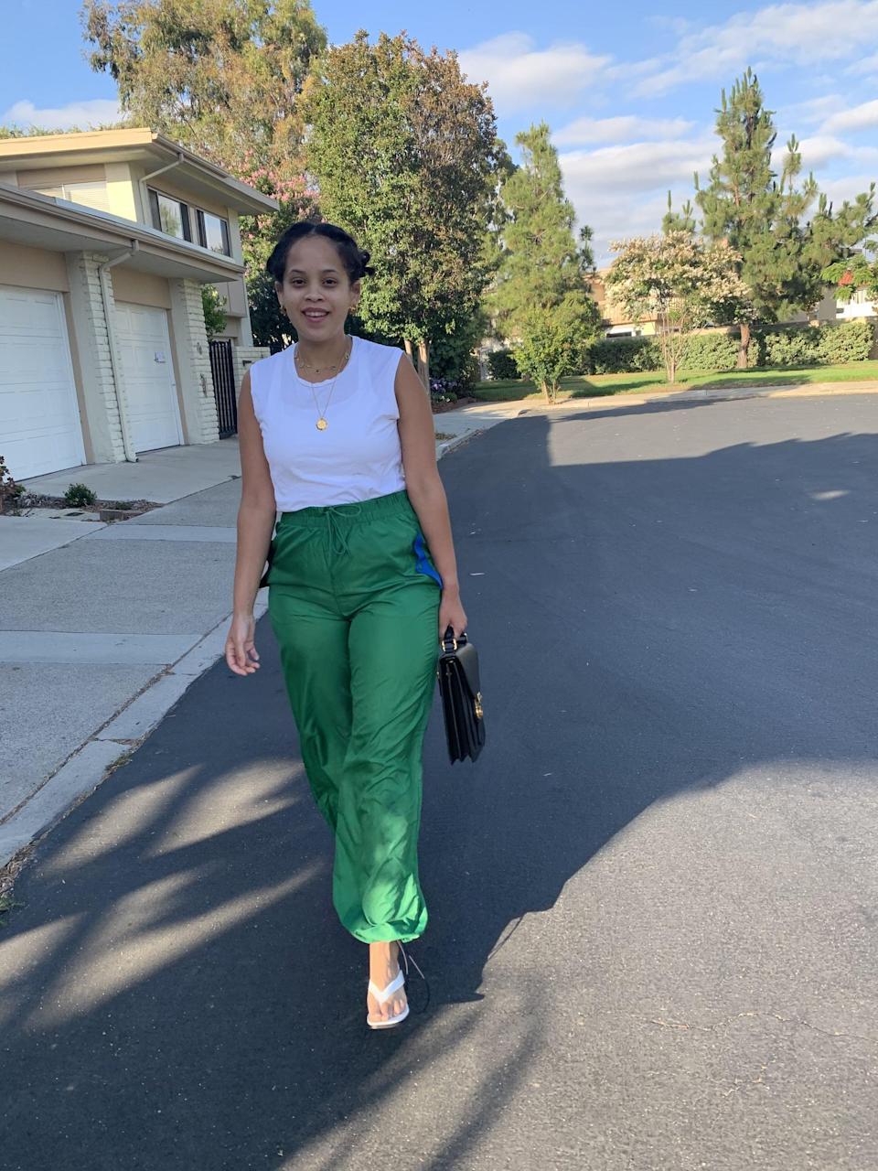 <p>When I want to be a lil' extra, I pop on a heel. Here my track pants are paired with Nasty Gal heels, Missoma jewelry, a Burberry handbag, and my favorite white tee by Handvaerk. </p>