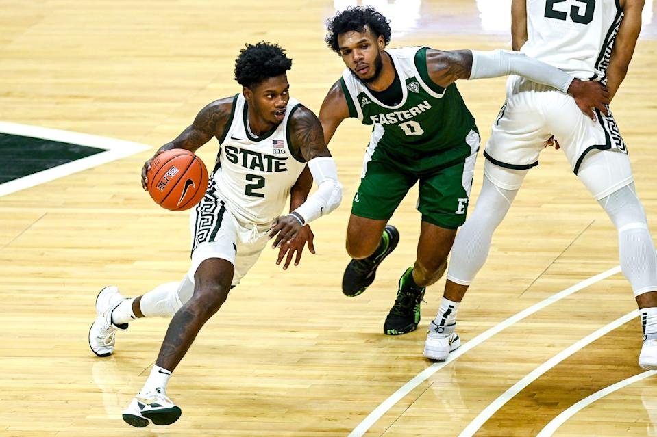 Michigan State's Rocket Watts, left, moves around Eastern Michigan's Yeikson Montero during the first half on Wednesday, Nov. 25, 2020, at the Breslin Center in East Lansing.