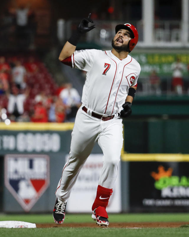 Cincinnati Reds' Eugenio Suarez celebrates after hitting a two-run home run off St. Louis Cardinals starting pitcher Austin Gomber during the seventh inning of a baseball game Tuesday, July 24, 2018, in Cincinnati. (AP Photo/John Minchillo)