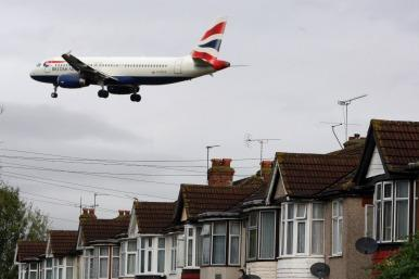 BA plane over houses in SE