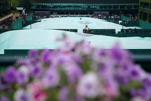 Covers on the outer courts as rain fell