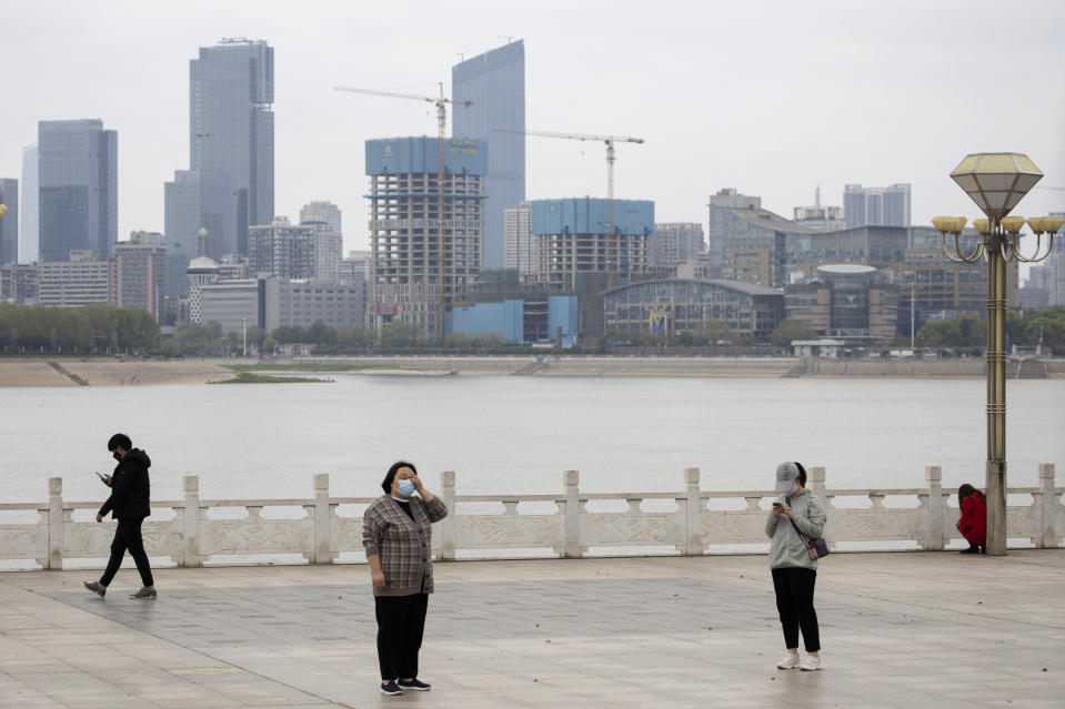 Residents observe social distancing at a park along the Yangtze River in Wuhan in central China's Wuhan province on Wednesday, April 1, 2020. Skepticism about China's reported coronavirus cases and deaths has swirled throughout the crisis, fueled by official efforts to quash bad news in the early days and a general distrust of the government. In any country, getting a complete picture of the infections amid the fog of war is virtually impossible. (AP Photo/Ng Han Guan)