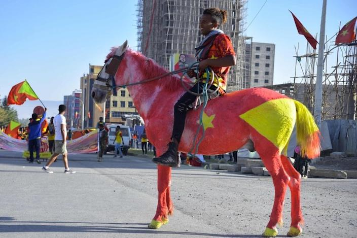 A man in Ethiopia's Mekelle city rides a horse painted in the colours of the Tigray regional flag - 19 February 2020