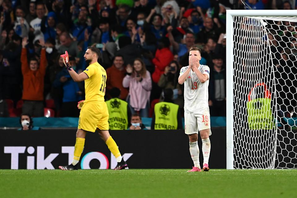 LONDON, ENGLAND - JULY 06: Dani Olmo of Spain reacts after missing their side's first penalty in the penalty shoot out during the UEFA Euro 2020 Championship Semi-final match between Italy and Spain at Wembley Stadium on July 06, 2021 in London, England. (Photo by Andy Rain - Pool/Getty Images)