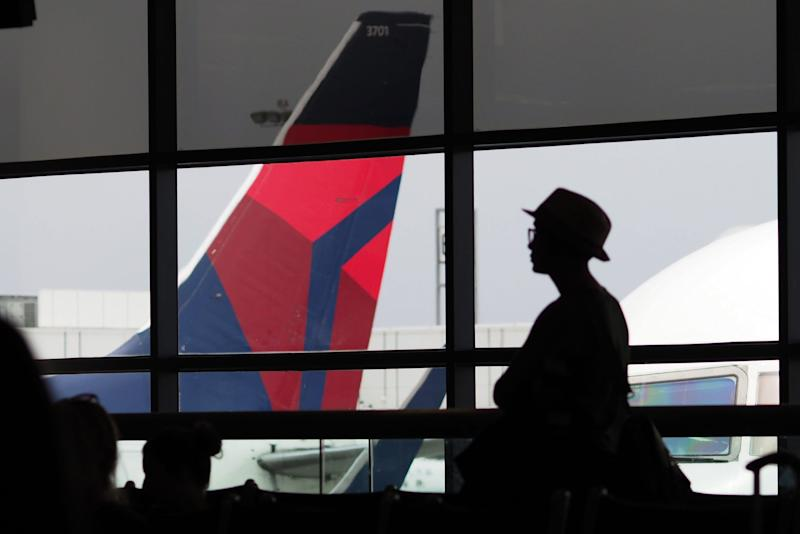 A passengers waits for a Delta Airlines flight in Terminal 5 at Los Angeles International Airport, May 4, 2017 in Los Angeles, California.
