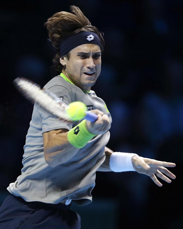 David Ferrer of Spain plays a return to Rafael Nadal of Spain during their ATP World Tour Finals tennis match at the O2 Arena in London, Tuesday, Nov. 5, 2013. (AP Photo/Kirsty Wigglesworth)