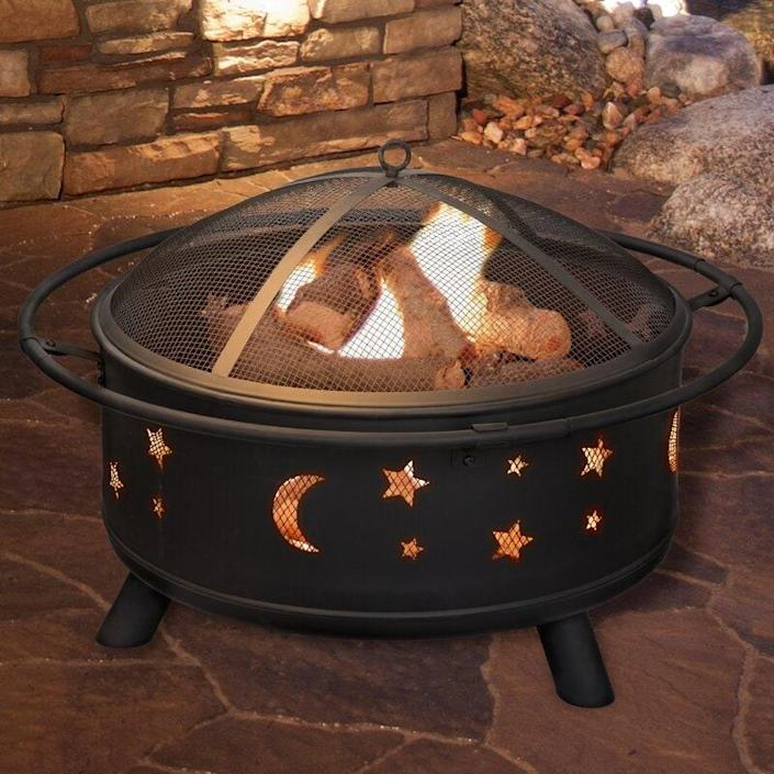 """We can't get enough of the stars and moons on this fire pit. It's truly unique! The pit, which measures 24 inches in diameter, comes complete with a log grate, spark screen, fire poker, and cover. $250, Wayfair. <a href=""""https://www.wayfair.com/outdoor/pdp/millwood-pines-jackman-star-and-moon-steel-wood-burning-fire-pit-w002671180.html"""" rel=""""nofollow noopener"""" target=""""_blank"""" data-ylk=""""slk:Get it now!"""" class=""""link rapid-noclick-resp"""">Get it now!</a>"""