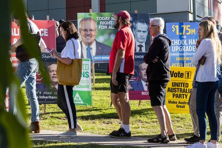 People voting in the seat of Dickson are seen arriving to vote at Patricks Road State School on Election Day in Brisbane, Queensland, Australia May 18, 2019. AAP Image/Glenn Hunt/via REUTERS
