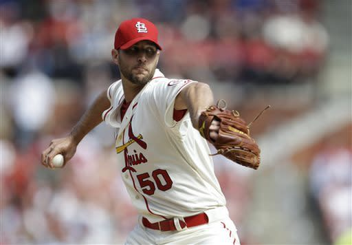 St. Louis Cardinals starting pitcher Adam Wainwright throw during the first inning of a baseball game against the Milwaukee Brewers, Saturday, April 13, 2013, in St. Louis. (AP Photo/Jeff Roberson)