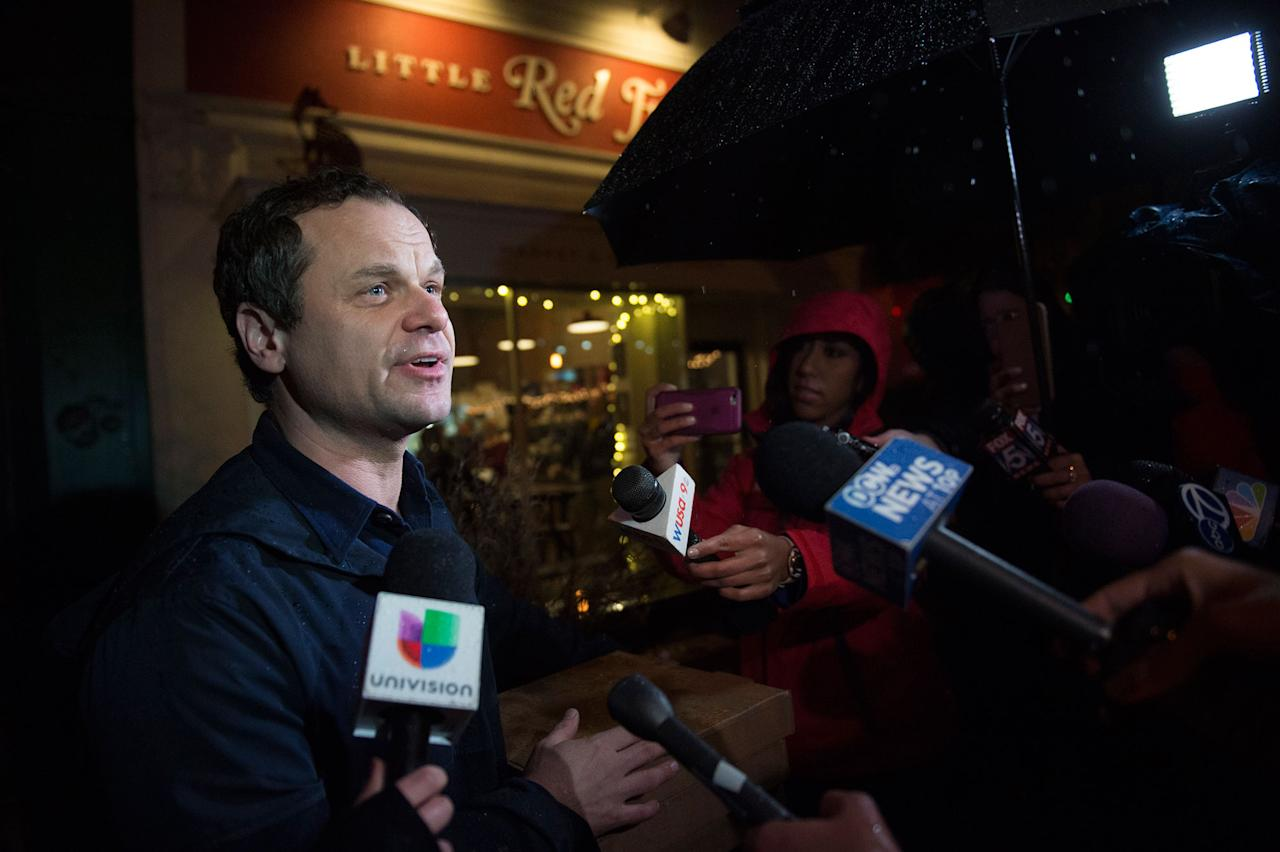 <p>Comet Ping Pong owner James Alefantis makes a brief statement outside his restaurant in Washington, D.C., on Tuesday, December 6, 2016. The business reopened after Edgar Maddison Welch from North Carolina, discharged his assault rifle at the popular Chevy Chase restaurant claiming he was there to investigate a fake news story on the Internet about a child sex ring. (Nikki Kahn/The Washington Post via Getty Images) </p>