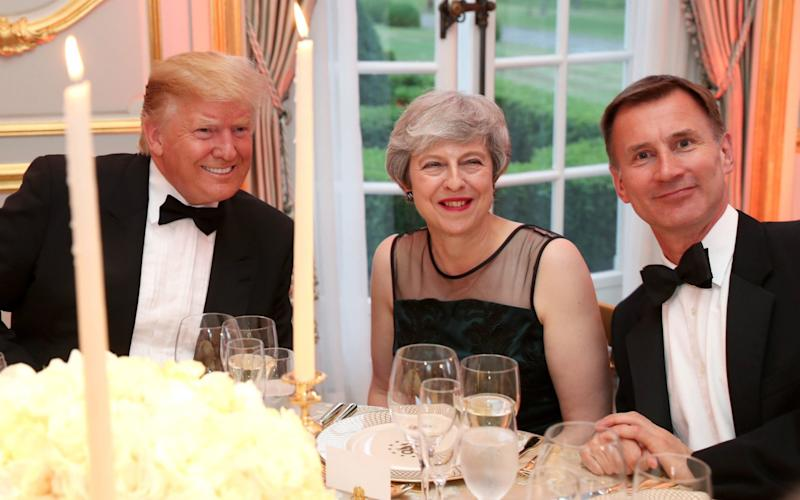 US President Donald Trump, Prime Minister Theresa May and Foreign Secretary Jeremy Hunt at the Return Dinner at Winfield House - PA