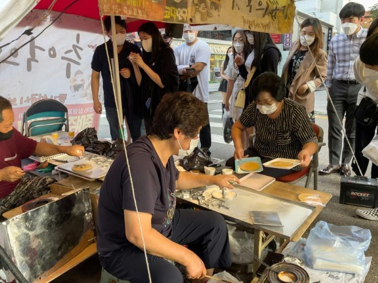 Lim and Jung's humble roadside dalgona operation is now one of the hottest spots in the South Korean capital (AFP/Yelim LEE)