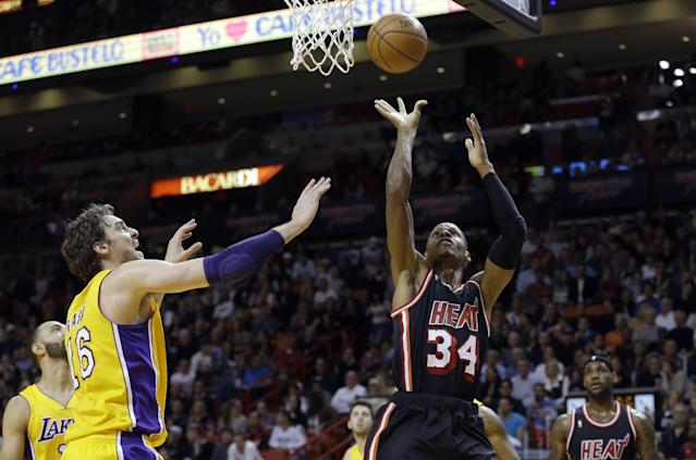 Miami Heat guard Ray Allen (34) shoots against the Los Angeles Lakers during the first quarter of an NBA basketball game in Miami, Thursday, Jan. 23, 2014. (AP Photo/Alan Diaz)