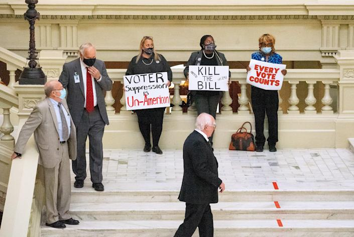 <p>Demonstrators protest inside Capitol building to oppose HB 531 on 8 March, 2021 in Atlanta</p> (Getty Images)