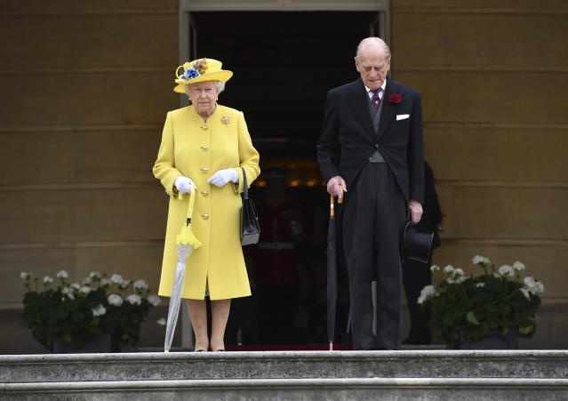 <p>Britain's Queen Elizabeth and Prince Philip observe a minute's silence, at the start of a garden party at Buckingham Palace in London, May 23, 2017. The Islamic State group claimed responsibility Tuesday for the suicide attack at an Ariana Grande show that left over 20 people dead and dozens injured. (Photo: Dominic Lipinski/AP) </p>