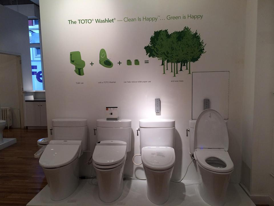 This Friday, Feb. 21, 2014, photo shows TOTO Washlet high tech toilets in the TOTO showroom in the Soho neighborhood of New York. A new generation of toilets may one day make toilet paper - and the need to put one's hands anywhere near the unspeakable - seem like chamber pots and outhouses: outdated and somewhat messy throwbacks reserved for camping trips. (AP Photo/Katherine Roth)