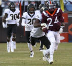 Virginia Tech's Terius Wheatley (24) has the ball stripped from him from behind by Wake Forest defender Nasir Greer (3) during the first quarter of an NCAA college football game Saturday, Nov. 9, 2019, in Blacksburg, Va. (Matt Gentry/The Roanoke Times via AP)