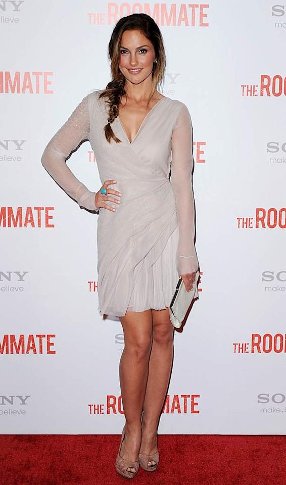 "Following in Leighton's footsteps was her equally ravishing ""Roommate"" co-star, Minka Kelly (""Friday Night Lights""), who popped a pose in a sheer wrap dress, which featured crystal embellishing and a plunging neckline. A loose ponytail, nude peep-toes, and a turquoise cocktail ring completed her lovely look. Jon Kopaloff/<a href=""http://www.filmmagic.com/"" target=""new"">FilmMagic.com</a> - January 23, 2011"