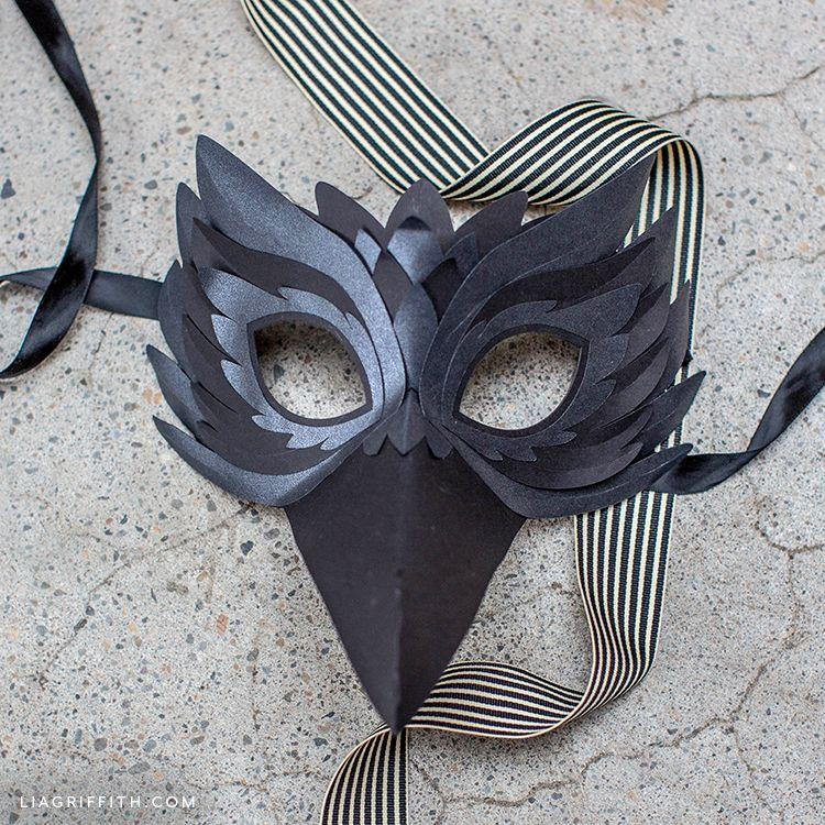 """<p>For a mask that will have everyone raving, this card stock paper raven mask is exactly what you need.</p><p><strong><em>Get the tutorial at <a href=""""https://liagriffith.com/paper-raven-mask/"""" rel=""""nofollow noopener"""" target=""""_blank"""" data-ylk=""""slk:Lia Griffith"""" class=""""link rapid-noclick-resp"""">Lia Griffith</a>. </em></strong></p>"""