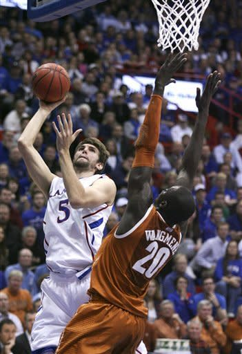 Kansas' Jeff Withey (5) takes a shot over Texas' Alexis Wangmene (20) in the first half of an NCAA college basketball game Saturday, March 3, 2012, in Lawrence, Kan. (AP Photo/Ed Zurga)