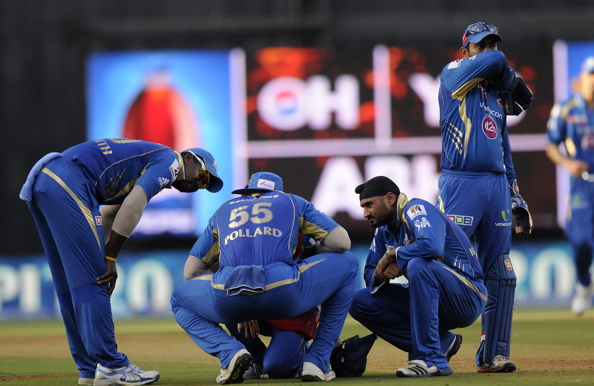 Dwayne smith of Mumbai Indians and Dinesh Karthik of Mumbai Indians check on teammate Kieron Pollard of Mumbai Indians as the latter gets hit by a ball during match 49 of the Pepsi Indian Premier League ( IPL) 2013  between The Mumbai Indians and the Chennai SUperkings held at the Wankhede Stadium in Mumbai on the 5th May 2013 ..Photo by Pal Pillai-IPL-SPORTZPICS  ..Use of this image is subject to the terms and conditions as outlined by the BCCI. These terms can be found by following this link:..https://ec.yimg.com/ec?url=http%3a%2f%2fwww.sportzpics.co.za%2fimage%2fI0000SoRagM2cIEc&t=1506178918&sig=awfSprWZtO3NrA2Mxci5tw--~D