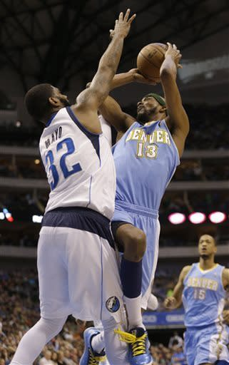 Denver Nuggets small forward Corey Brewer (13) shoots against Dallas Mavericks shooting guard O.J. Mayo (32) during the first half of an NBA basketball game on Friday, April 12, 2013, in Dallas. (AP Photo/LM Otero)