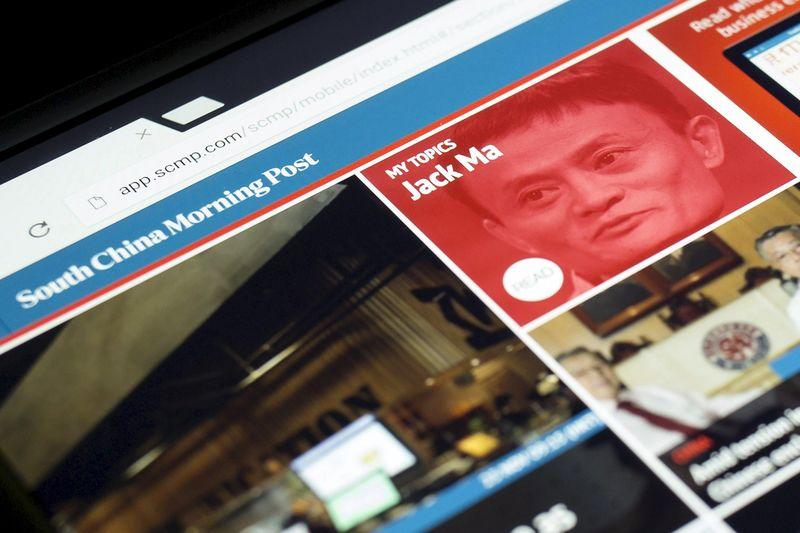 File photo illustration shows the South China Morning Post website and an image of Jack Ma, founder and executive chairman of Alibaba Group Holding Ltd, on a computer in Hong Kong