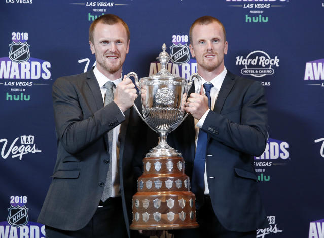 Daniel Sedin, right, and Henrik Sedin pose with the King Clancy Memorial Trophy after winning the award at the NHL Awards, Wednesday, June 20, 2018, in Las Vegas. (AP Photo/John Locher)